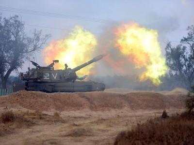 A large artillery gun firing